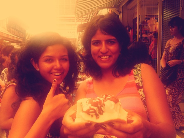 Suby and Roshni with coconut ice cream. Happy!