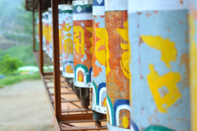 Old prayer wheels at a Buddhist Monastry. These wheels have mantras written and rolled inside it. Spinning the wheel as the same effect as orally reciting the prayers.